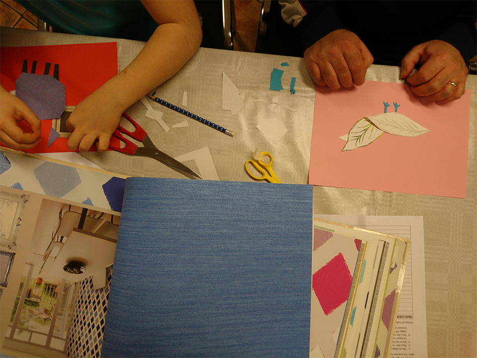 både barn och vuxna skapade av färgade papper och tapetprover
